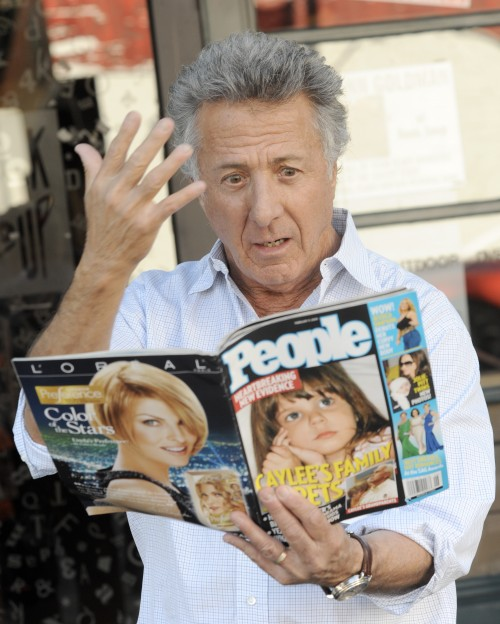 Dustin Hoffman can't believe his eyes as she checks out the latest issue of People Magazine in West Hollywood, Ca