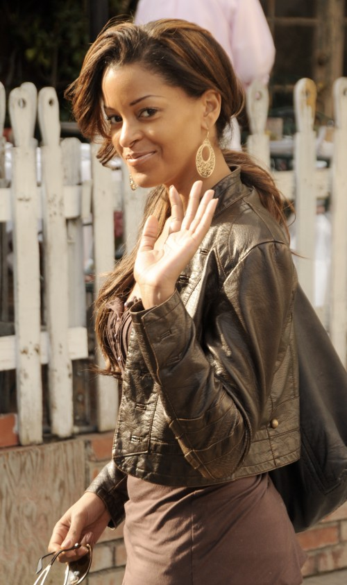 Deal Or No Deal model Claudia Jordan waves hello as she heads to The Ivy restaurant in Beverly Hills, Ca
