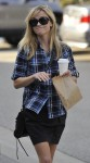 Reese Witherspoon catches up with a friend as she spends the afternoon in Brentwood, Ca