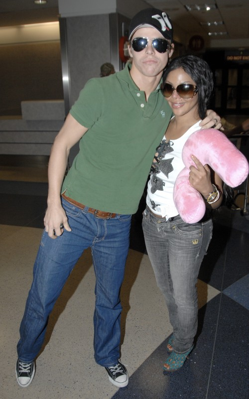 Derek Hough and Lil Kim the dance partners who got voted off Dancing With The Stars arrive at LAX Airport