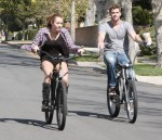Miley Cyrus and boyfriend Liam Hemsworth go for a bike ride through her Toluca Lake, CA neighborhood