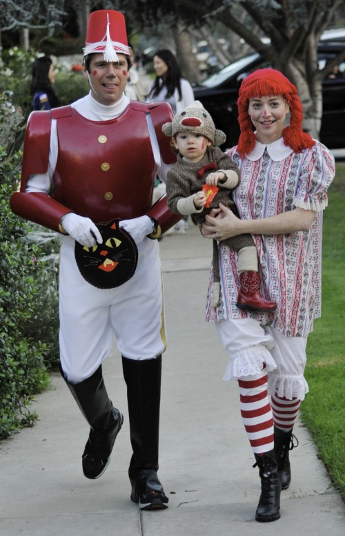 Alyson Hannigan dressed as Raggedy Anne and her husband Alexis Denisoff as a toy soldier take their daughter Satyana Trick or Treating in Santa Monica, Ca