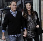 Alanis Morrisette and husband all smiles as they walk hand in hand in Venice, Ca