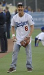 Matthew McConaughey throws the ceremonial first pitch before the game between the New York Mets and Los Angeles Dodgers